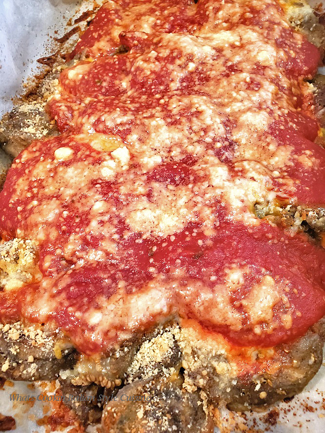 This is an Italian baked casserole with tomato sauce, Parmesan Cheese and shredded layers of Mozzarella and eggplant called Eggplant Parmesan