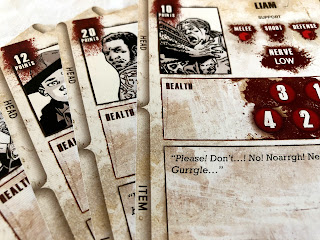 A selection of character cards from The Walking Dead: All Out War miniatures game