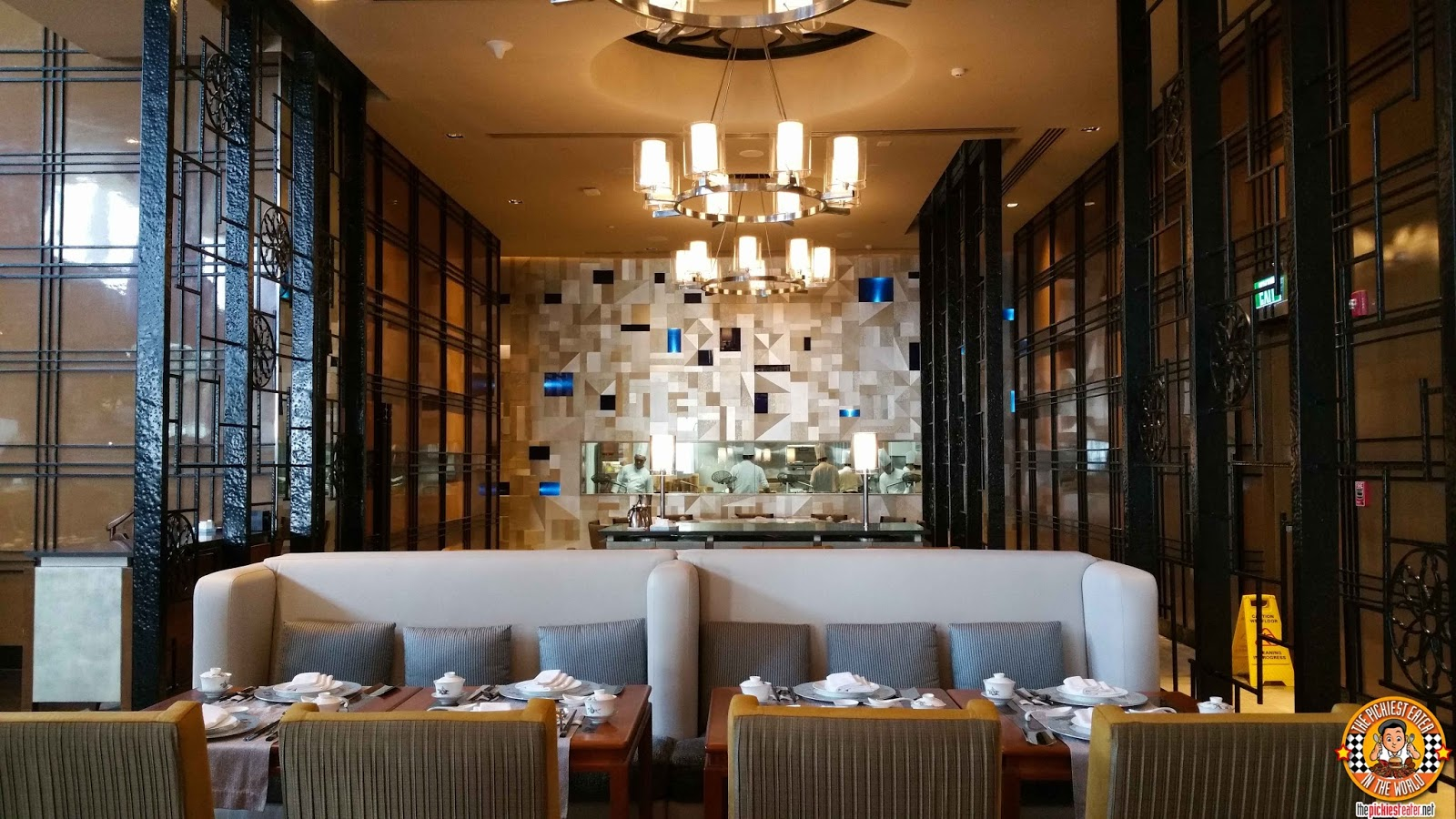upon entering the restaurant it is apparent that the conrad hotel manila group spared no expense in creating a lavish and elegant dining space
