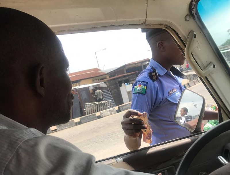 Policeman Caught On Camera Taking Bribe - Photos