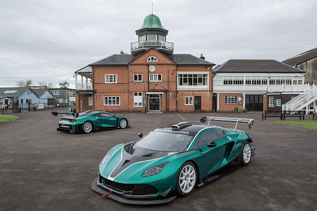 A pair of Arrinera Hussarya GTs outside the Clubhouse