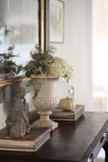 neutral fall decor white hydrangeas crusty urn