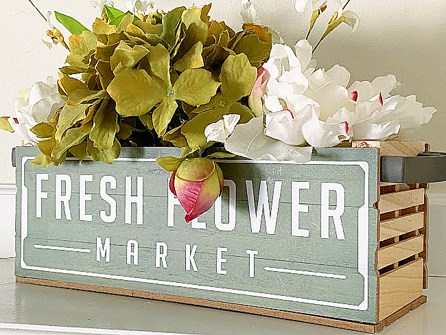 market crate filled wit faux flowers