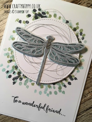 This image is a close up of a white handmade card showing a dragonfly stamped in Pool Party and Mint Macaron using the Dragonfly Dreams stamp set by Stampin' Up!
