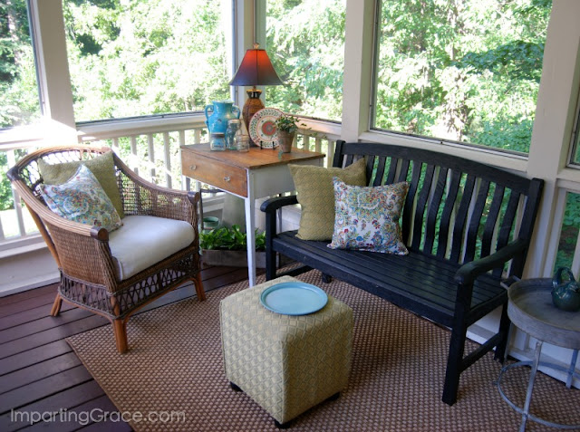 Comfortable sitting area features simple furnishings and accessories