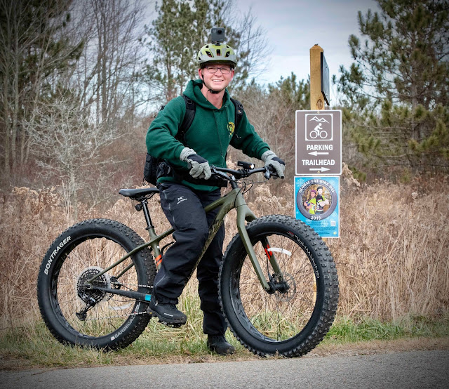 Story author Brad Parsons, and Michigan Department of Natural Resources videographer, is shown on 2019's Global Fat Bike Day.