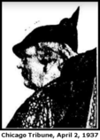 A news clipping photo showing a middle-aged white woman in profile. She has short, curled or pinned-up medium-dark hair and is wearing a dark hat.