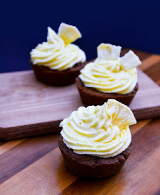 Vegan Gingerbread Cupcakes with Pineapple Frosting on board