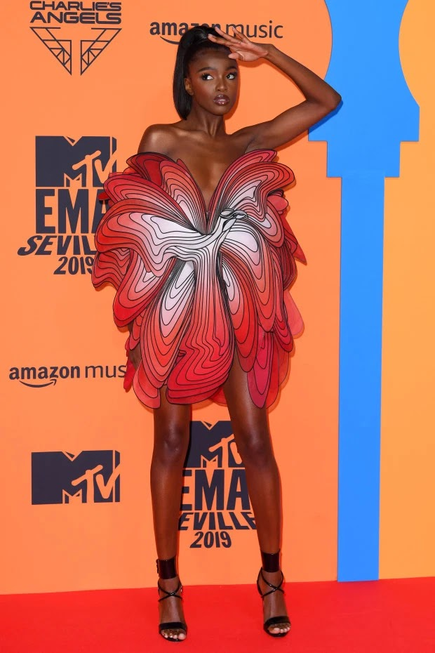 Leomie Anderson wore a high fashion red mini dress for the occasion