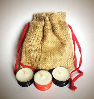Jute gift bag of upcycled wine bottle cap candles