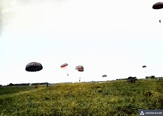 Replacement troops learned to parachute in a school in Lipa.  Image source:  US National Archives. Colorized courtesy of Algorithmia.