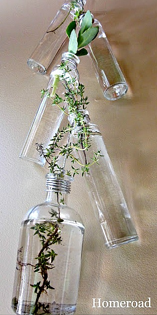 DIY Hanging repurposed and recycled thrift store bottles. Homeroad.net
