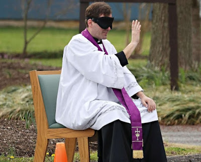 priest in blindfold