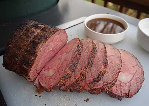 Sliced beef ribeye roast cooked on a Big Green Egg.