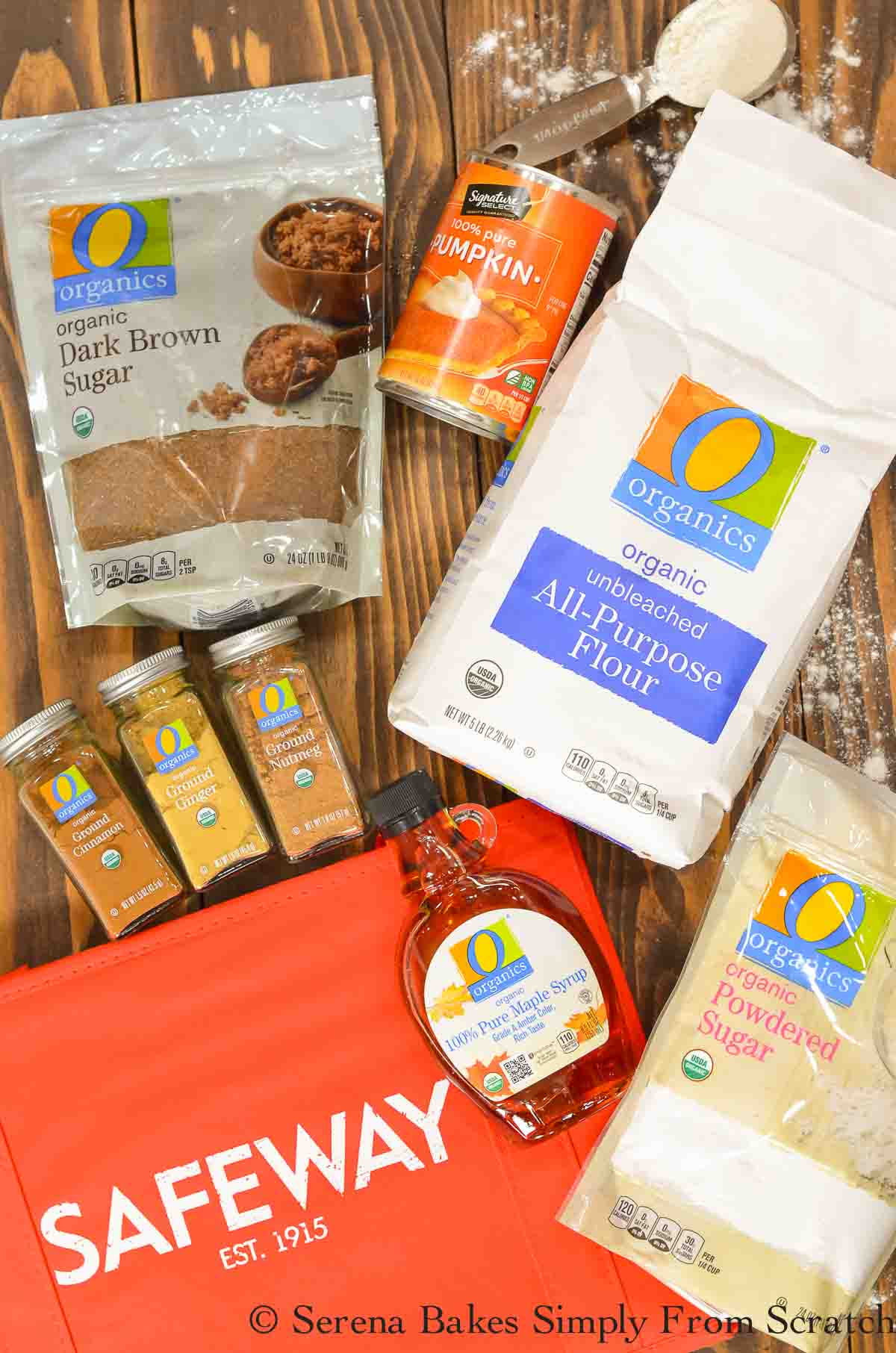 A red Safeway Bag and O Organic Products on a wooden board,