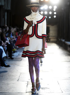 2017 Cruise Collection Gucci white jacket and skirt with red and blue edging worn over lilac lace leggings