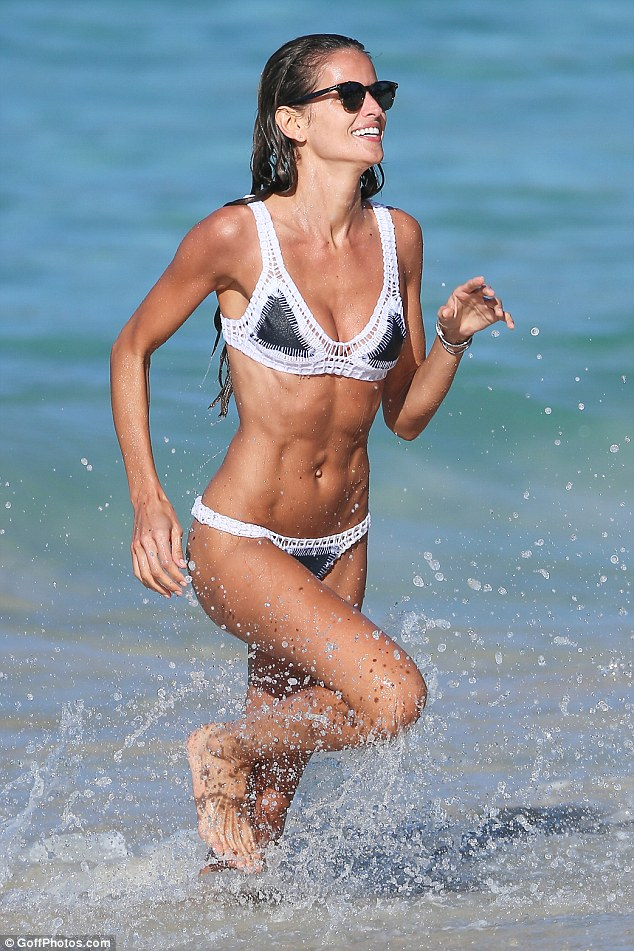 Izabel Goulart flaunts her supermodel figure in TINY crochet bikini as she frolics on the beach in St Barts
