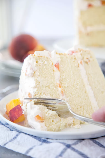 Vanilla Peach Layer Cake - Vanilla Peach Layer Cake is a perfect dessert for summer. Tender, moist cake is layered with a sweet peaches and cream frosting, with chunks of fresh peaches.