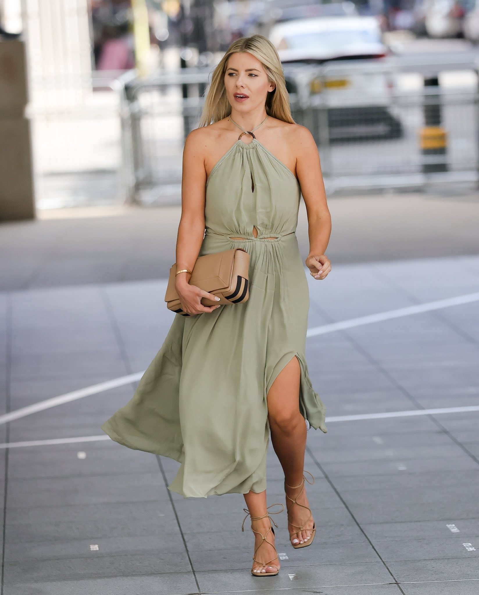 Mollie King shows off her bronzed legs in a summer-ready khaki maxi dress as she arrives at Broadcasting House for her BBC Radio 1 show