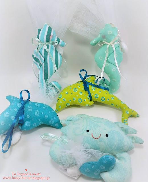 Ιππόκαμποι, δελφίνια, καβουράκι σε διαφορετικές αποχρώσεις ως μπομπονιέρα βάπτισης