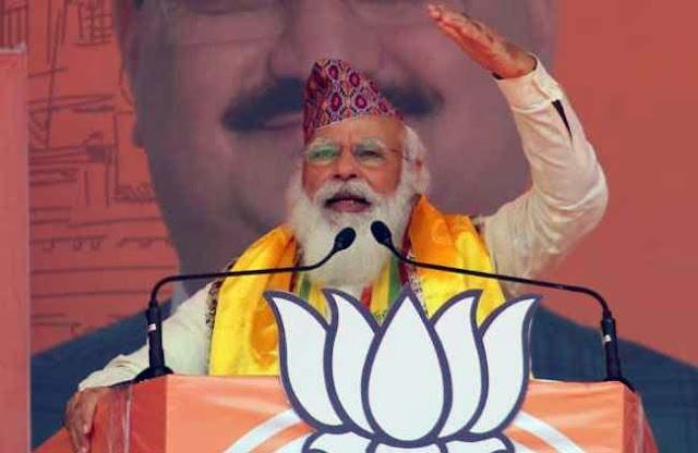 Narendra Modi wearing Nepali Topi in Siligutri