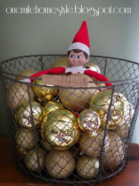 Wire basket of gold ornaments - Christmas decor