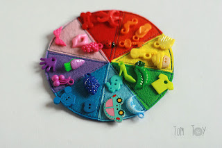 Felt color wheel with wooden clothespins and colorful trinkets handmade by TomToy