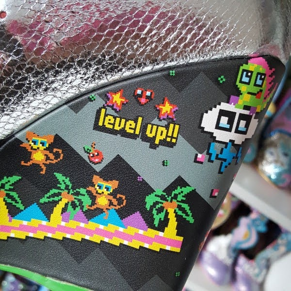 close up of monkey pixel game print on side of shoe