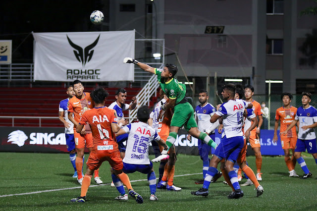 Tanjong Pagar United's GK Zharfan Rohaizad fisted away the danger