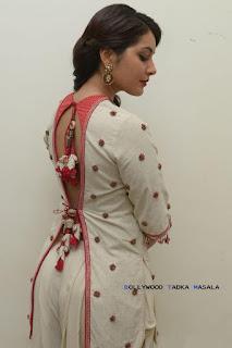 Rashi Khanna in a backless embellished kurta and dhoti style pants by Nikasha and Suhani Pittie