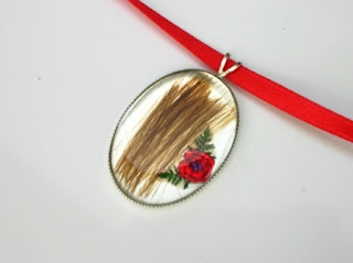 Sterling silver pendant for a loved ones hair and poppy flower