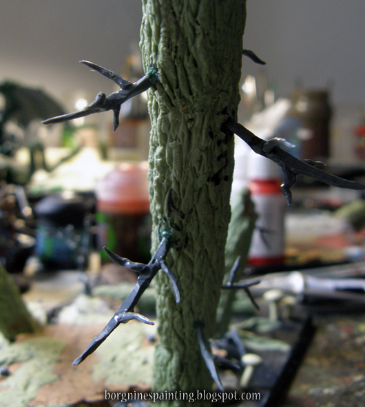 The 'sprue' branches are now seen mounted on the 'tree', with many additional plastic twigs from the Dryad set glued around them, creating a branching effect.