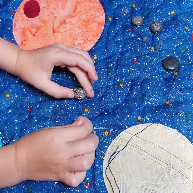 Hand sewing on asteroids