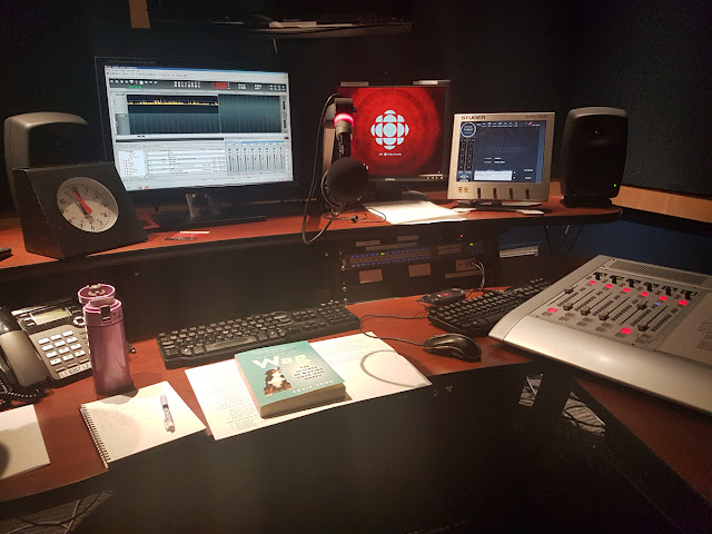 A copy of Wag: The Science of Making Your Dog Happy, along with my notes and a flask of water, in a radio booth at the CBC offices in Vancouver.