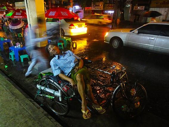 tired rickshaw men