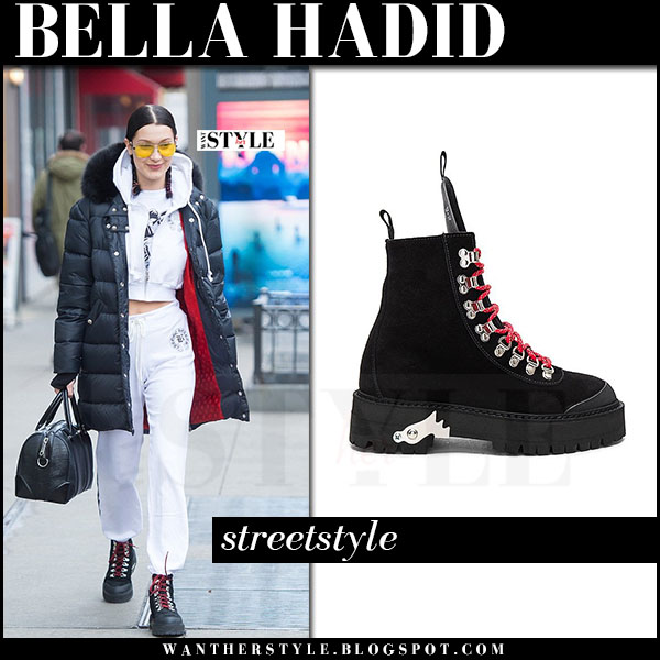 Bella Hadid in black hiking boots, white sweatpants and black puffer coat what she wore streetstyle march 2017