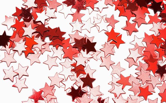 Kerst wallpaper met roze, witte en rode sterren
