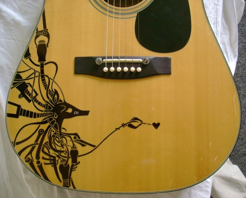 07-Patrick-Fisher-Personalise-your-Guitar-with-Drawings-www-designstack-co