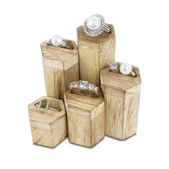 A 5-piece hexagon jewelry display risers with rings on top.