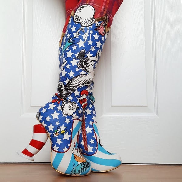 blue star print knee high boots with red and white striped hat shaped heel