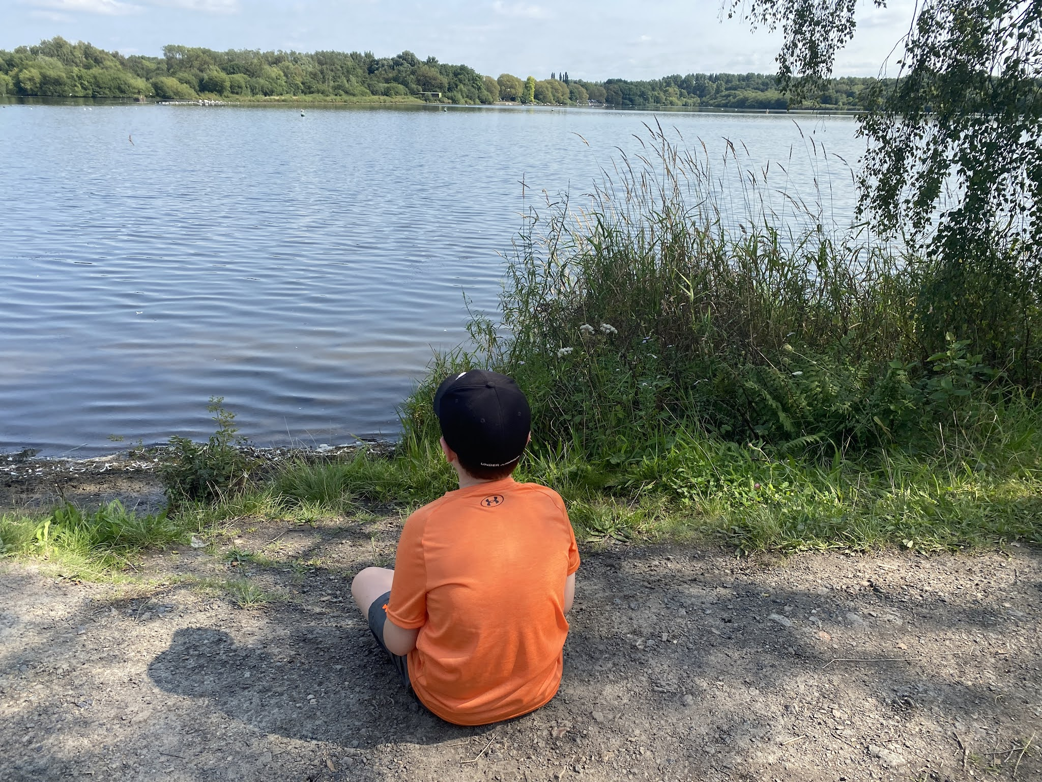 boy sat by the water