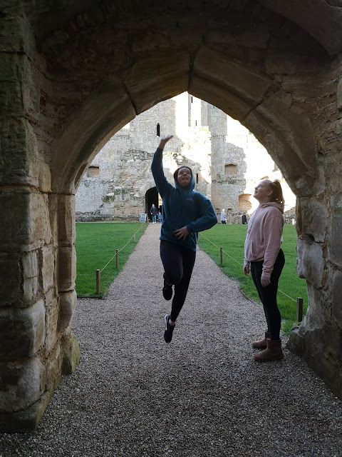 Teens having fun at Bodiam Castle