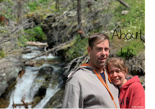 A picture of the husband and wife creators of Wolfe Stew with a waterfall in the background.
