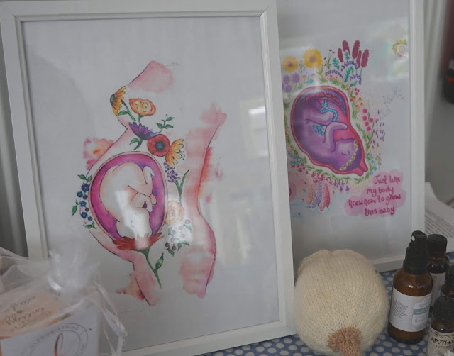image shows two hand painted positive birth images