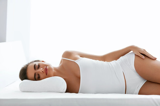 lower back pain - woman-sleeping-on-orthopedic-pillow