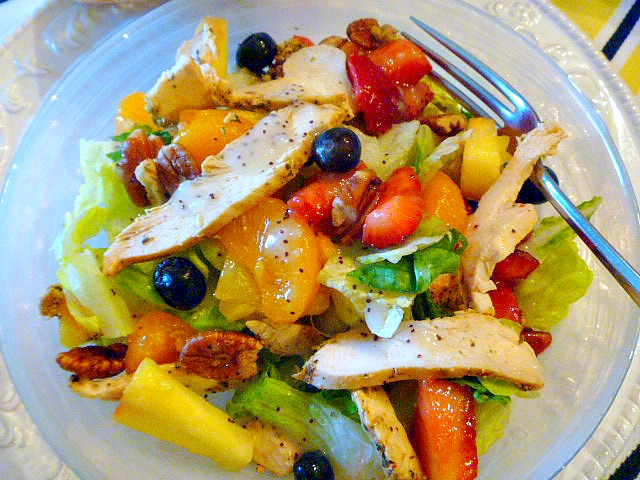 California Salad: A delicious salad filled with fresh fruit and moist roasted chicken, doused with a sweet dressing!  Slice of Southern