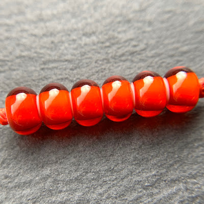 Handmade lampwork glass beads in CiM Firedragon by Laura Sparling