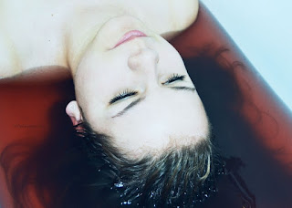 woman laying on her back about to get a facial treatment.jpeg