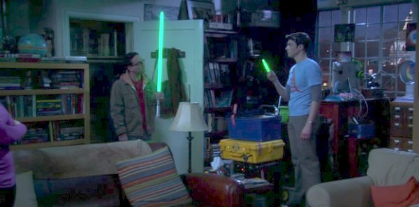 The Big Bang Theory - Leonard holds a big light saber, Sheldon holds a small glow stick
