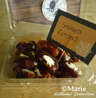 Dates stuffed with a cream cheese filling and served as stuffed roaches